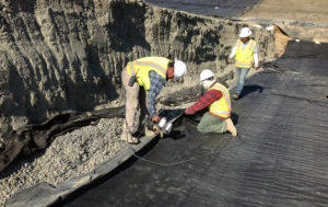 During June, 14 International Lining Technology crew members install 367,500 square feet of 80 mill HD, textiles and GCL at the Coeur Rochester Stage 3 project.