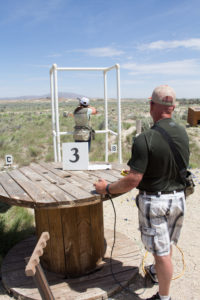 Photo shows Corey Glennon and Courtney Murphy from Canyon Construction shooting clays