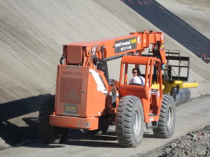 image of worker driving heavy equipment