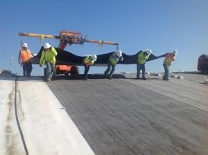 ILT crew installing plastic lining.
