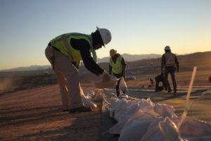 ILT crew places sandbags